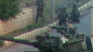 An image of soldiers and a tank taken on an amateur video on 25 April reportedly in Deraa