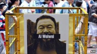A poster of detained Chinese artist and activist Ai Weiwei at a protest in Hong Kong on 22 April 2011