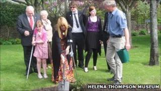 Hazel Barker planting a Bill Barker Rose