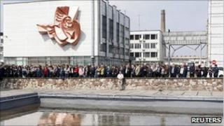 People attend a memorial ceremony at the now-defunct nuclear power plant in Chernobyl on Tuesday