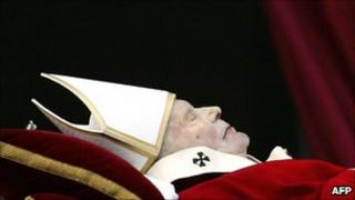 This file picture taken on April 4, 2005 at The Vatican shows Pope John Paul II body carried to be transferred from the Apostolic Palace to St Peter's Basilica.