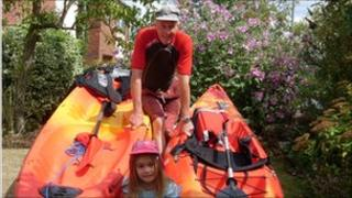Hugh Turner with his kayaks