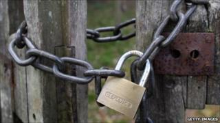 A padlock on a gate