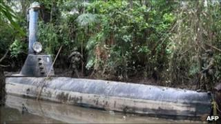 Colombian soldiers guard a homemade submersible in a rural area of Timbiqui in February 2011