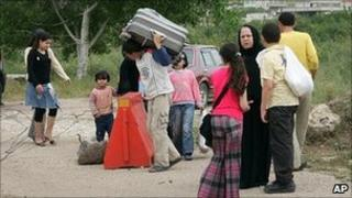 Syrian family arrives in Lebanon after fleeing across the border from Tell Kalakh. 28 April 2011
