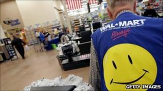 The back of a Wal-Mart employee at one of its stores