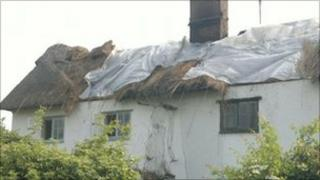 The fire-damaged cottages in Blaxhall