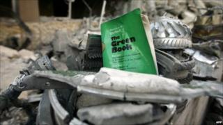 A copy of Col Gadaffi's Green Book amid rubble in Tripoli on 10/4/11