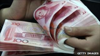Bank staff deals with Chinese currency