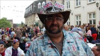 A reveller at a street party in Tetbury