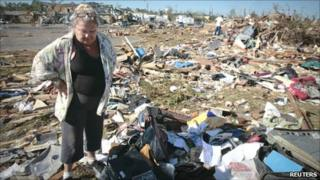 A resident of Tuscaloosa looking at the remains of her home