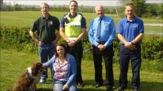Left to right back row: Pets of Pershore owner Chris Barnard, Pcso Simon Williams, Eckington Parish Councillor Arthur Ore and Wychavon District Councillor Trevor Clark. Front row: DogWalkerWatch co-ordinator Liz Roffey and Coco the dog.