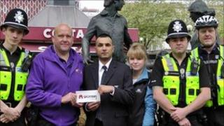 From left to right: Pc James Knox, town host John Timms, Boots security worker Mazar Iqbal, Cotswold Outdoor Leisure worker Daisy Gaston, Sgt Kirk Whitehouse and Pcso Steve Richardson