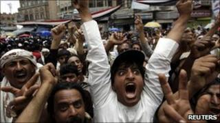 Anti-government protesters shout slogans during a rally to demand the ouster of Yemen's president
