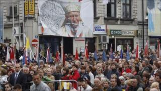 People take part in a Holy Mass in the town of Wadowice, the birth place of the late Pope John Paul II, on 1 May 2011