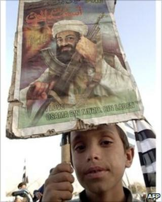 File picture of Pakistani boy with Bin Laden poster in 2002