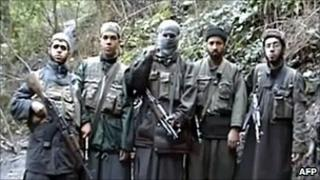 A picture taken from a video posted on April 25 on internet and attributed to Al-Qaeda in the Islamic Maghreb (AQIM) shows five armed youths, one of them masked, announcing that they would defend prisoners detained in Morocco.
