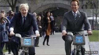Boris Johnson and Arnold Schwarzenegger riding bikes.