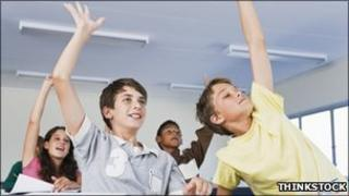 Boys raising hands [Thinkstock]