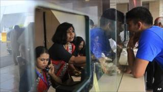 A passenger makes queries at an Air India ticket counter