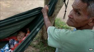 A Thai refugee rests at a refugee camp near the Thai-Cambodian frontline in Surin province, in northeastern Thailand