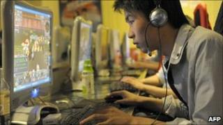 A Chinese man plays online games at an internet cafe in Beijing (file photo)