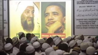 Pictures of Osama Bin Laden (L) and Barack Obama (R) projected at a meeting of an Islamist group in Jakarta, Indonesia - 4 May 2011