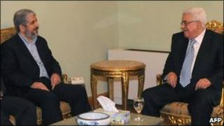 Palestinian Authority President and Fatah head Mahmud Abbas (R) talks to Hamas leader Khaled Meshaal