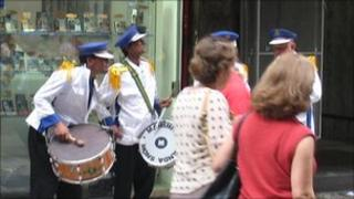 Band playing outside mobile phone shop in Sao Paulo city centre
