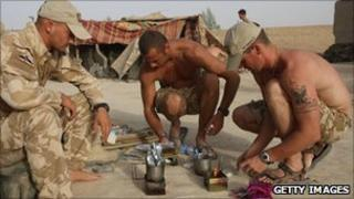 Soldiers cooking rations