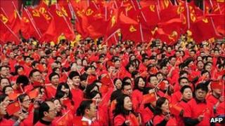 Members and their families gather for a rally celebrating the forthcoming 90th anniversary of the Chinese Communist Party