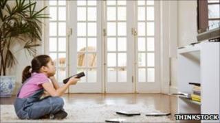 Child watching TV alone