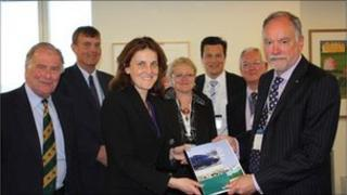 Transport Minister Theresa Villiers is presented with the rail action plan for Kent