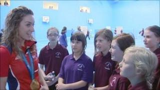 Amy Williams speaking to pupils at the new school sports centre named after her