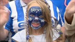 A young girl celebrates Brighton's success