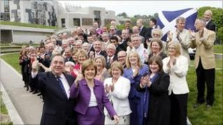 SNP leader Alex Salmond and SNP deputy leader Nicola Sturgeon with newly elected SNP MSPs outside Scottish Parliament in Edinburgh