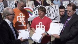Don't Cut Us Out campaigners presenting their petition to Peter Catchpole, the council's cabinet member for adult social services