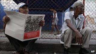 Man reads new economic guidelines in Havana, Cuba. 9 May 2011