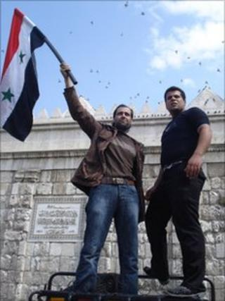 Pro-government supporters in Damascus