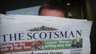 Man reading Scotsman