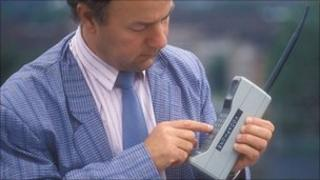 Man using 1980s-style mobile phone