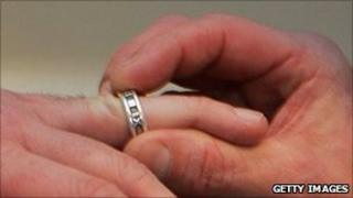 Same-sex couple marking partnership with ring