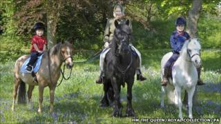 Queen Elizabeth II rides in Windsor Great Park with her two youngest grandchildren, James, Viscount Severn (left - three) and Lady Louise Windsor (seven). This picture, taken on Easter Monday, has been released May 10, 2011, by The Queen to mark the start of the Royal Windsor Horse Show.