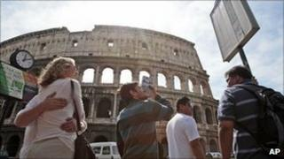 People stand in front of the Colosseum in Rome. Photo: April 2011