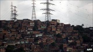 Electricity pylons over a shantytown in Caracas, Venezuela. Photo: April 2011