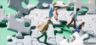 Model figures on shaky jigsaw