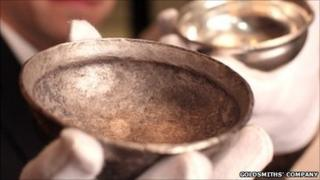 Archaeologist Frank Hargrave and silversmith Alex Brogden examine a 2,000 -year-old Iron-Age silver bowl.