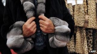 Customer trying on fur coat in Paris - file pic