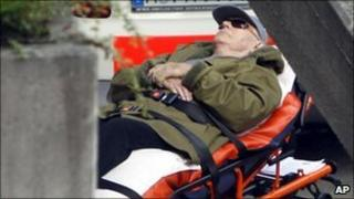John Demjanjuk arrives on a stretcher at the court building in Munich, Germany, 11 May 2011