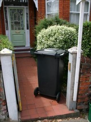 A wheelie bin outside a house